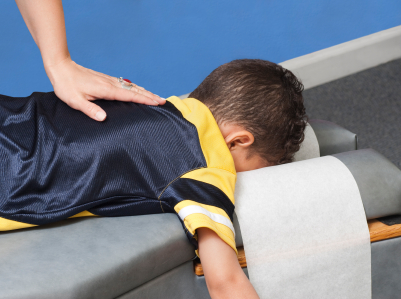 child getting a chiropractic adjustment