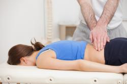 woman getting lumbar decompression treatment