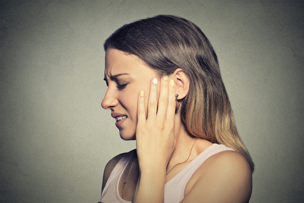 woman with tmj needs chiropractic care.